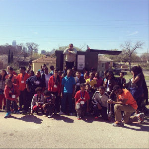 Are those two kids on the end a little camera shy or just shocked at Professor Dumpster's housing choice? Students from Oak Cliff in Dallas stop by for a dumpster tour.